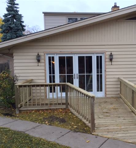 Wooden Wheelchair Ramp and Deck with French Doors Installed by BILD in Brookfield
