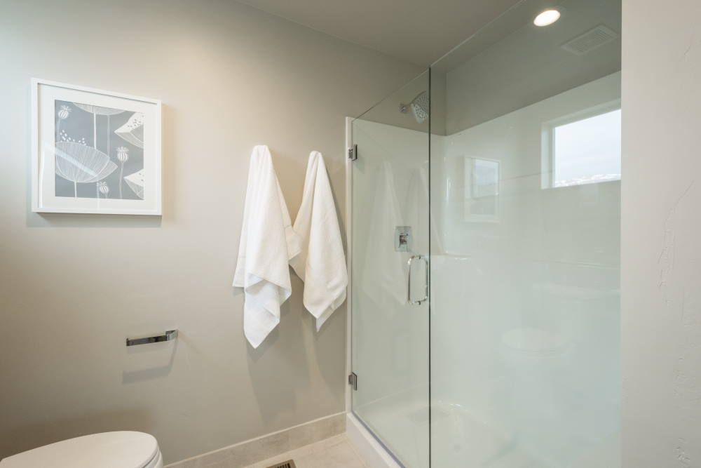 Superior-designed fiberglass and acrylic walk-in shower surround by BILD, Milwaukee, WI.